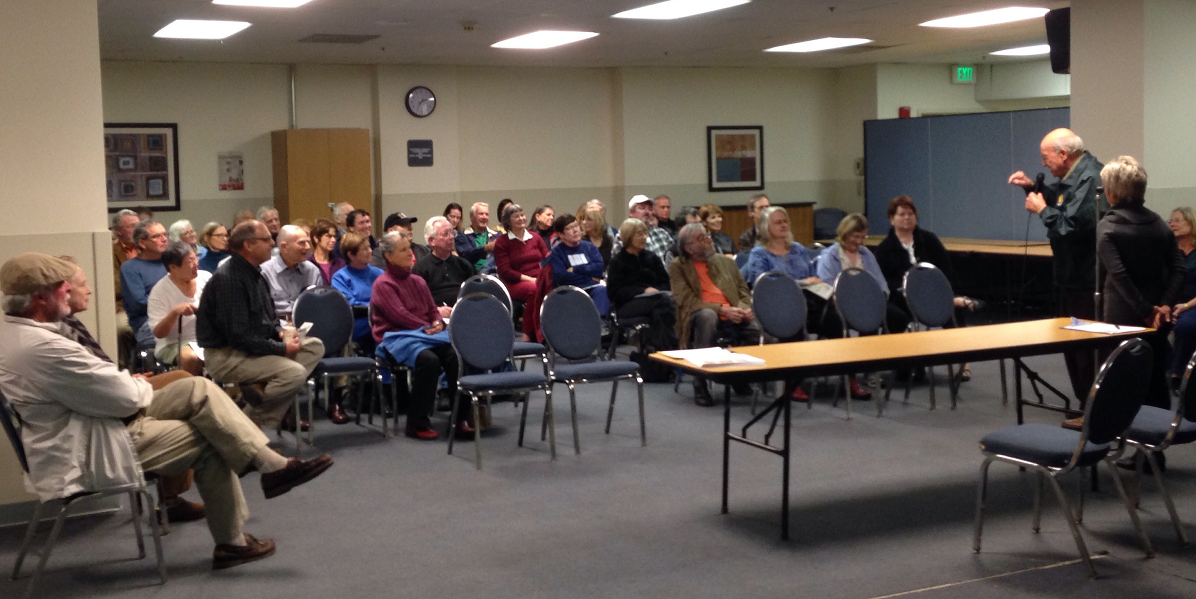 Doug Siden addresses a crowded room at the Friends of Crown Beach meeting.