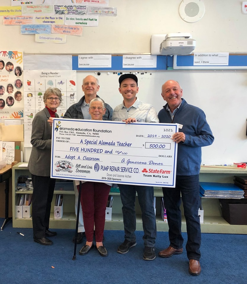 Courtesy photo &nbsp&nbsp Pictured from left to right: Judy Goodwin, Maya Lin School principal; Jim and Mandy Tham, donors; Brian Dodson, teacher and award recipient; and Bill Sonneman, representing Alameda Education Foundation. The Thams donated $500 to support Dodson's classroom endeavors.