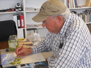 George B. Humphreys works on a watercolor in the Mastick drawing and painting class.