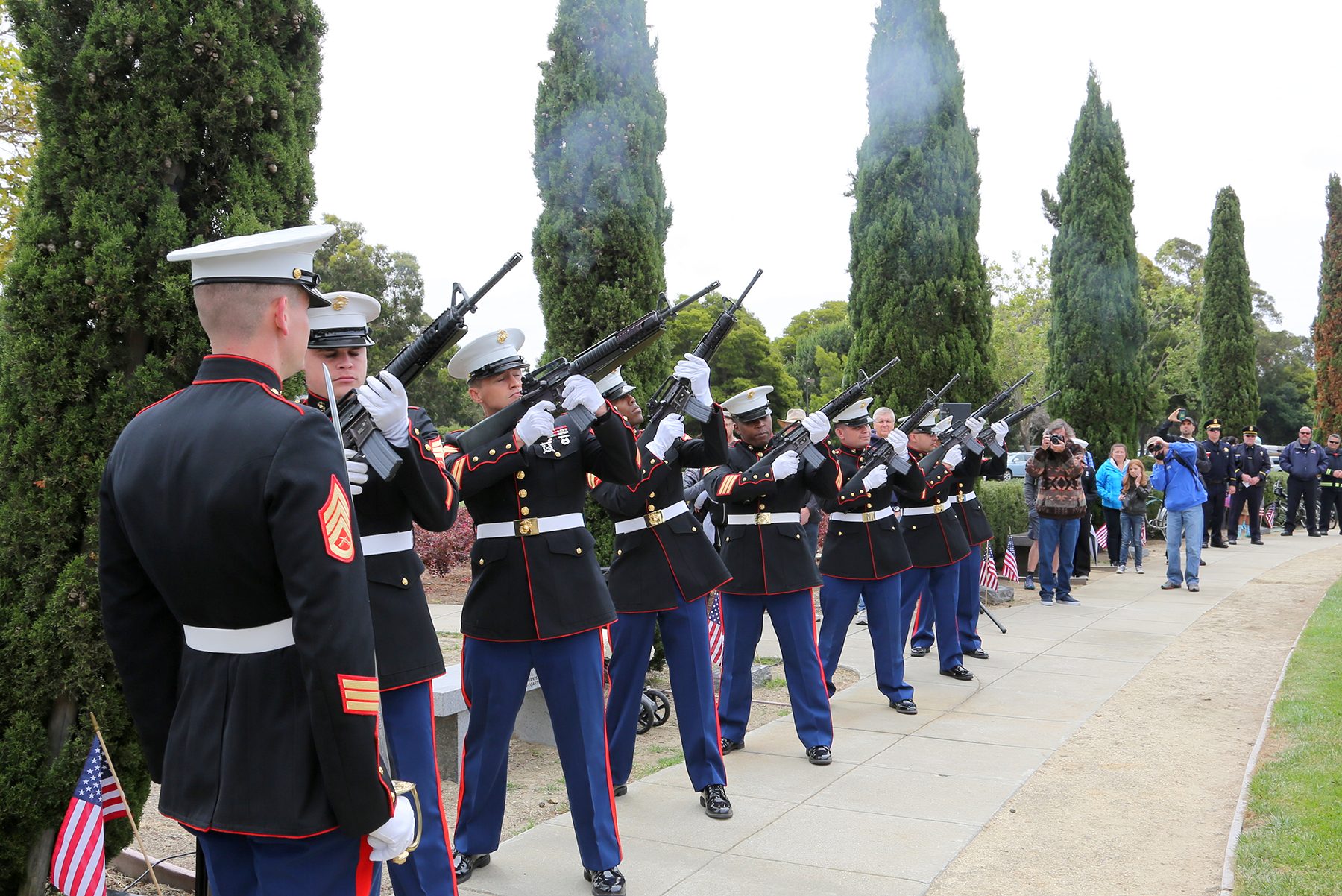 Courtesy photo  Marines fire off a salute during last year's Memorial Day Ceremony in Veterans Park on Bay Farm Island.