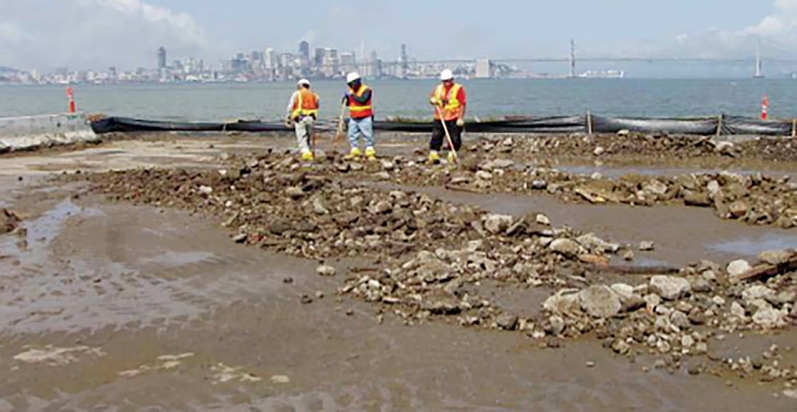 Richard Bangert &nbsp&nbsp Tetra Tech Workers clean up at Alameda Point in this 2007 photograph.