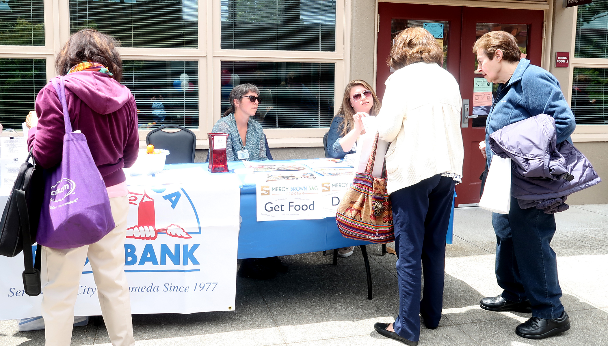AEC &nbsp&nbsp Living Seniors stopped by Alameda Food Bank's table at Mastick Senior Center's celebration of National Senior Health and Fitness Day on May 30.