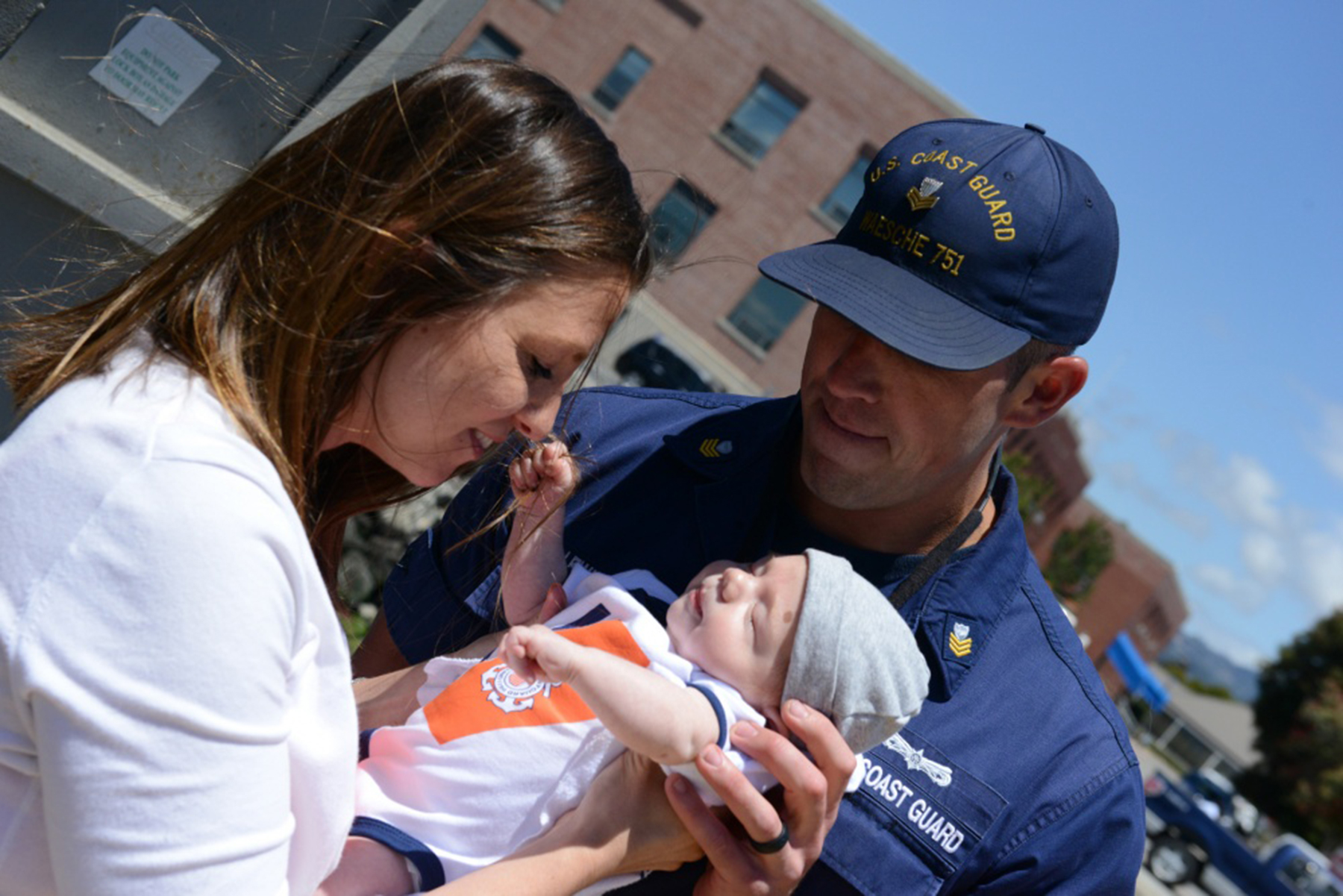 Coast Guard Chief Petty Officer Sarah Foster   Petty Officer 1st Class Ryan Lewis, Coast Guard Cutter Waesche crewmember, greets his wife and newborn upon the ship's return to homeport at Coast Guard Island Wednesday, June 15. The ship returned after completing a 109-day deployment.