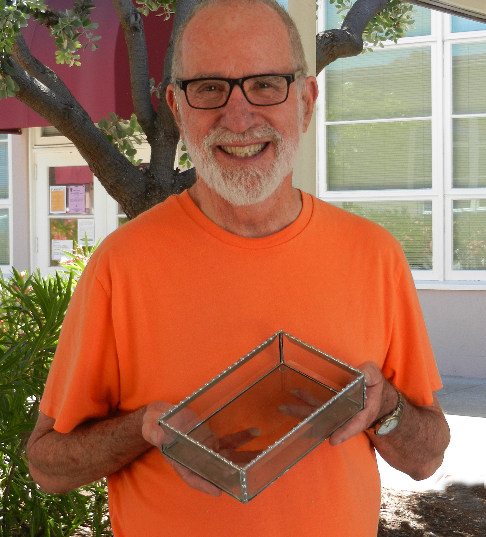 Courtesy photo  Alex Reisbord shows a stained-glass piece he created in a class at Mastick Senior Center.