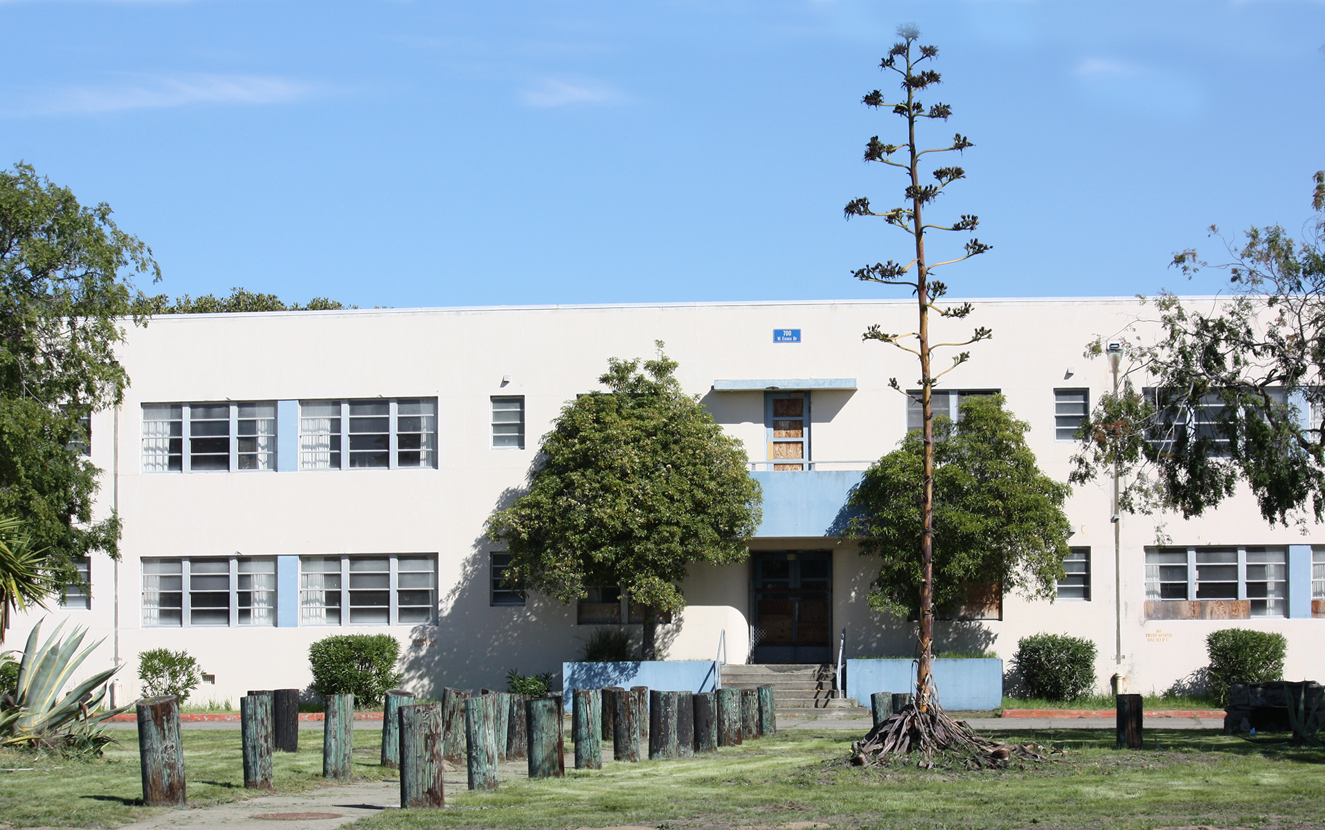 Photo by Dennis Evanosky A century plant has breathed its last in front of the Todd Street entrance to the Bachelor Officers Quarters on Alameda Point. The school district hopes to breathe new life into this building.