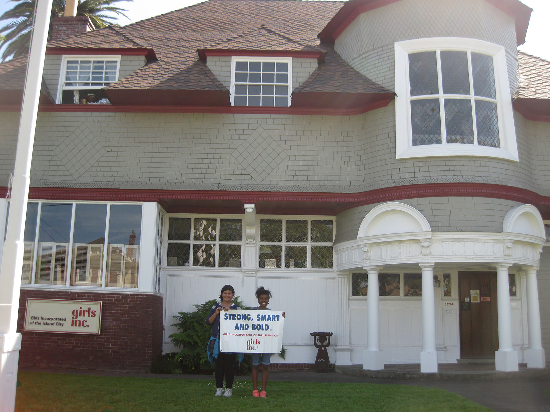 A pair of Girls Inc. members stand in front of the Dr. Edith Meyers Center on Santa Clara Avenue. They invite you to Girls Inc.'s 50th birthday party this Saturday. Photo courtesy Girls Inc.