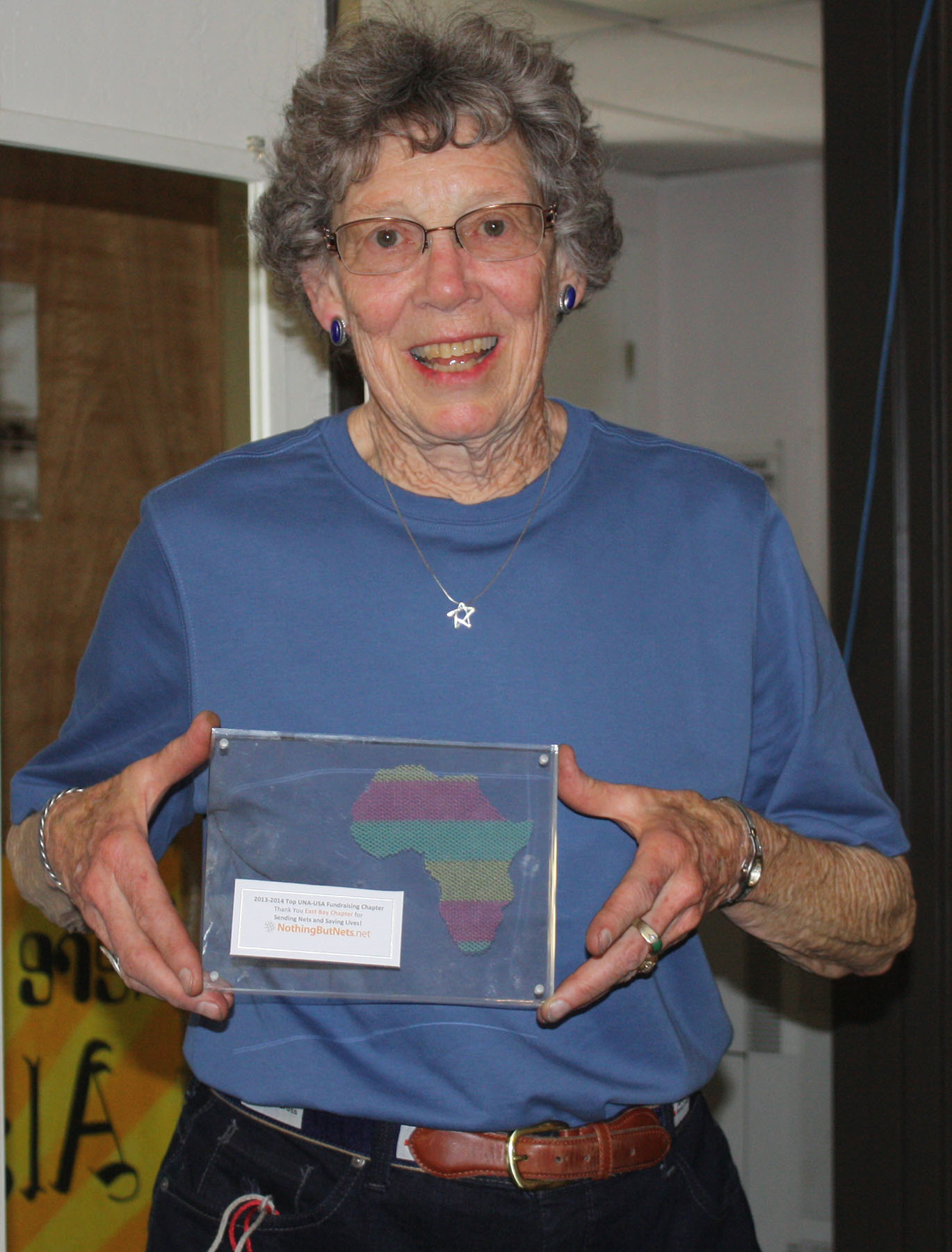 Dennis Evanosky - Joanne Robinson, Red Cross Youth Advisor, shows off the award Alameda's network earned this year.