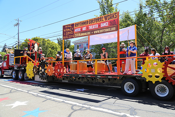 Kevin Francis Barrett - The whirring gears of the award-winning Rhythmix Cultural Works parade float accompanied the rousing sounds of the Taiko drums and other musical instruments in this year's July Fourth Parade last Friday.