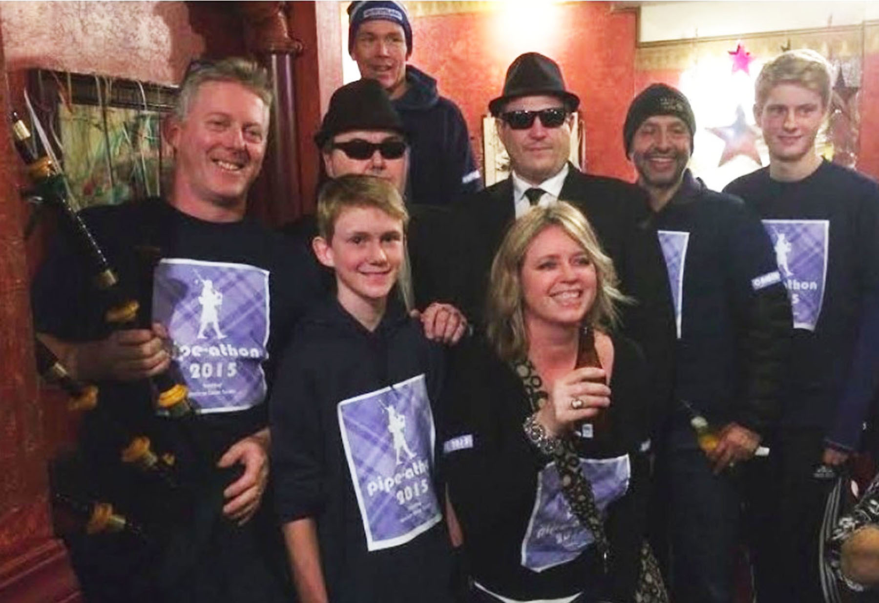 """Andy MacKay  Andy MacKay, far left, and Team Pipe-A-Thon members Joe """"Jake Blues"""" Donohoe, Jamie """"Elwood Blues"""" Eckmier, Ron """"The Collector"""" Manabat, Rod """"Tarantino"""" Ortiz, Ken """"Fittipaldi"""" Johnson thank the community for its generosity on New Year's Eve."""
