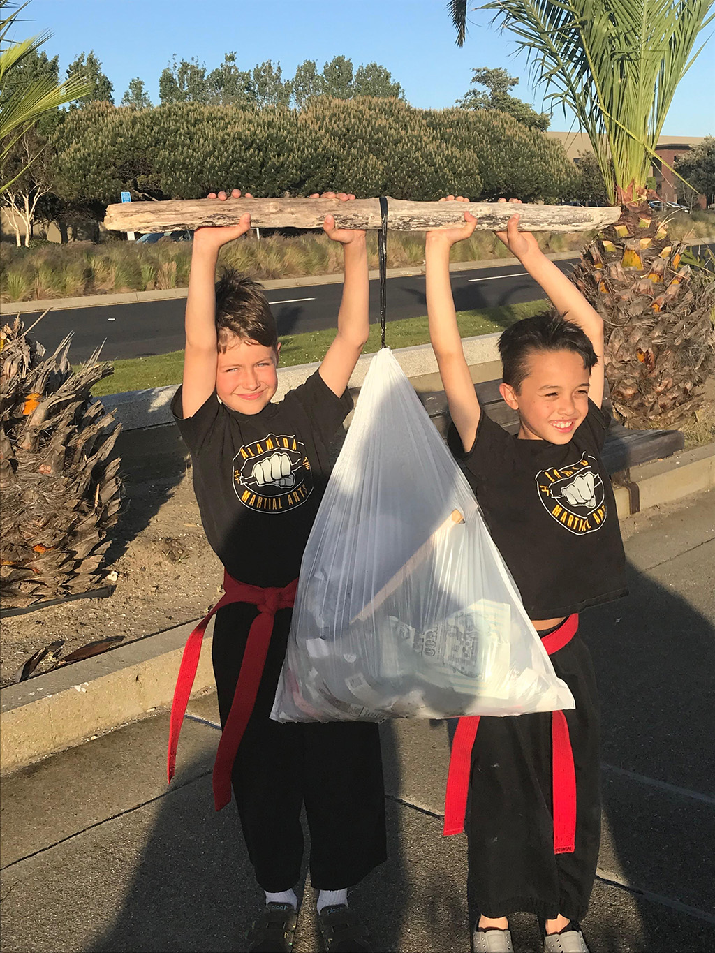 Frank Nijenkamp &nbsp&nbsp Martial arts students including Francisco Ninjenkamp (left) and Marcus Dalander took the day to celebrate both Earth Day and their instructor's birthday with a surprise beach cleanup April 22.