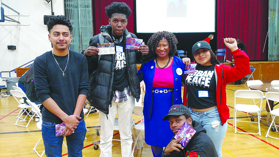 """Gabrielle """"Gaby"""" Dolphin &nbsp&nbsp Left to right, Encinal High School students Jonathan Hernandez, Ronnie Coleman, Veronica Canas and Reinhart Nderitu (kneeling) surround Civil Rights Attorney Pamela Price. They represent the """"Political and Proud"""" at a Feb. 21 event designed to get young people energized and involved in the political process."""
