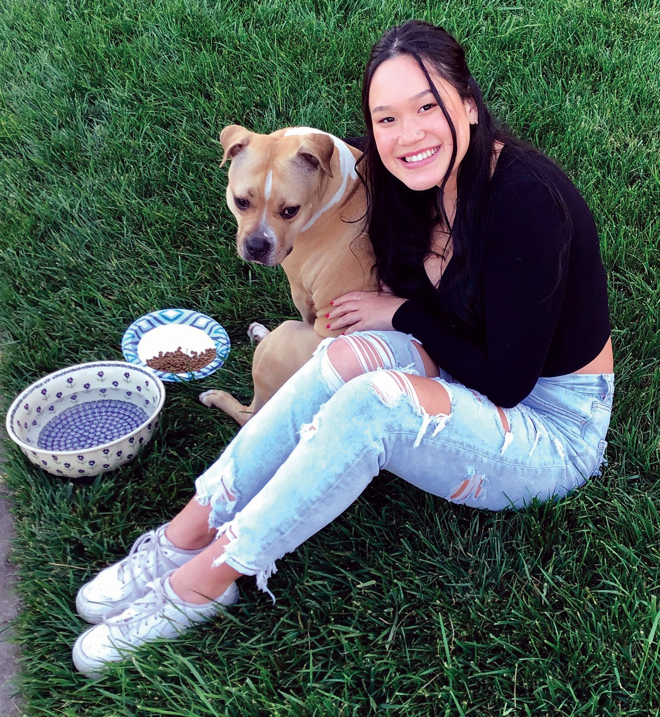 """Lawrence Freeman &nbsp&nbsp Dog whisperer and rescuer, Hannah Boles, patiently waits with """"Sweetie"""" as she reaches out for help to get the wayward pooch back to her homeless owner."""