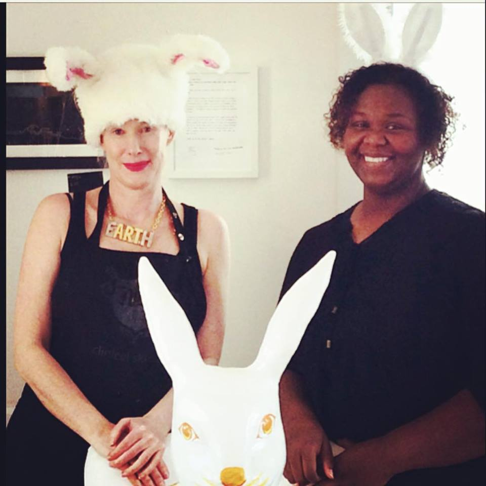 Courtesy photo &nbsp&nbsp Susan Dressler, owner of Nofu Skin Studio, (left) and Janis Hillard sport their Easter Bunny ears as they announce a new art exhibition entitled Electrified Fruit.