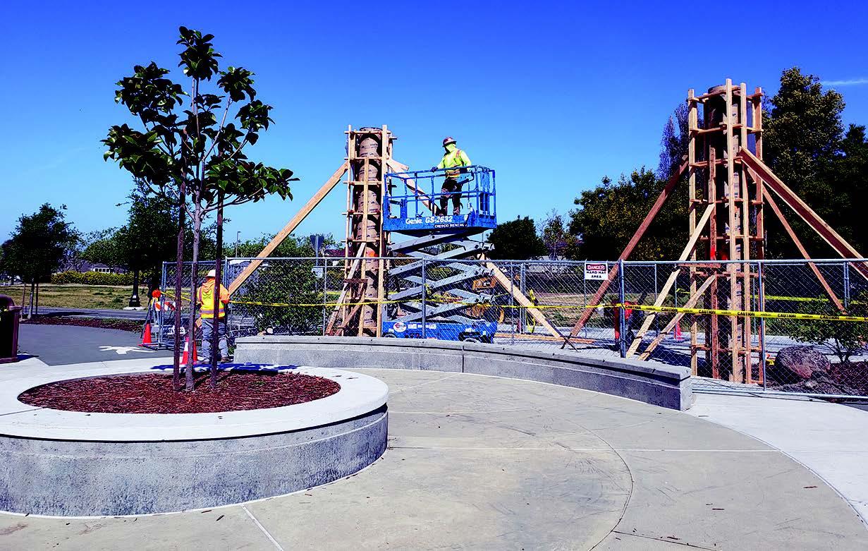 """Work crews began installing """"Gateway Columns,"""" public art by Norman Moore, at Jean Sweeney Open Space Park last week."""