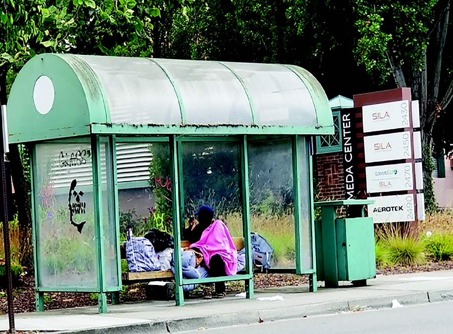 A homeless man uses a bus stop in Marina Village in this 2019 photograph. The city hopes to use the $285,767 in proposed funds from Alameda County to help the homeless community in Alameda. The city will use the funds to help find permanent housing for the homeless and help those on the verge of homelessness pay living expenses.