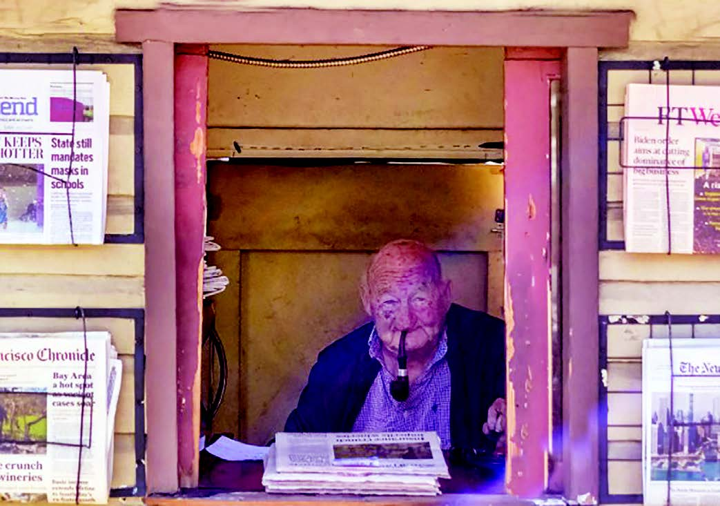 Framed by newspapers, Stan Hallmark is back at selling papers and observing life at the newsstand at Park Street and Santa Clara Avenue