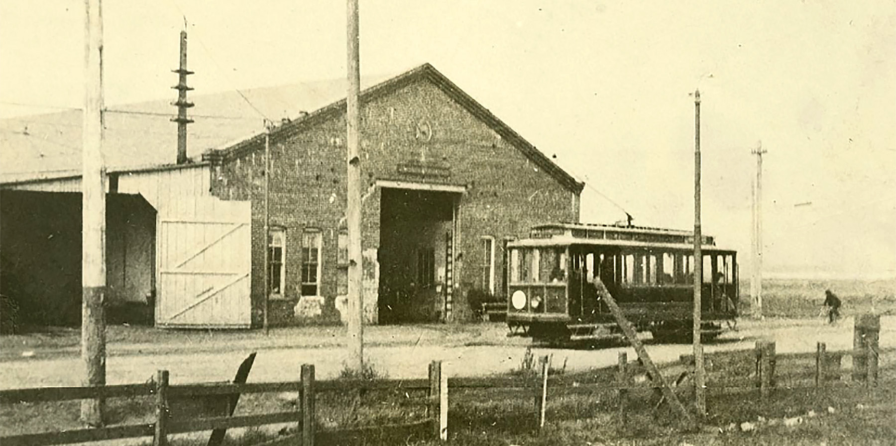 William Gardiner Transportation Collection     This building stood at Atlantic Avenue and Webster Street. It served first as a carbarn and stables for Theodor Meetz' horse-car lines and later as a power station when the lines were converted to electic-powered streetcars, like the one pictured.