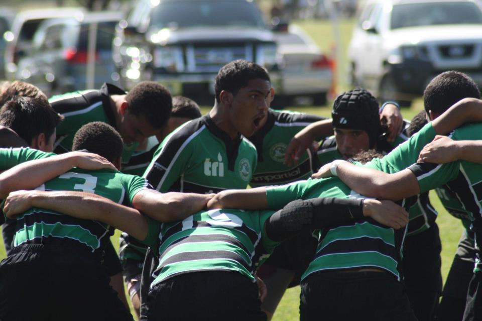 The Alameda Islanders rugby team huddles up.