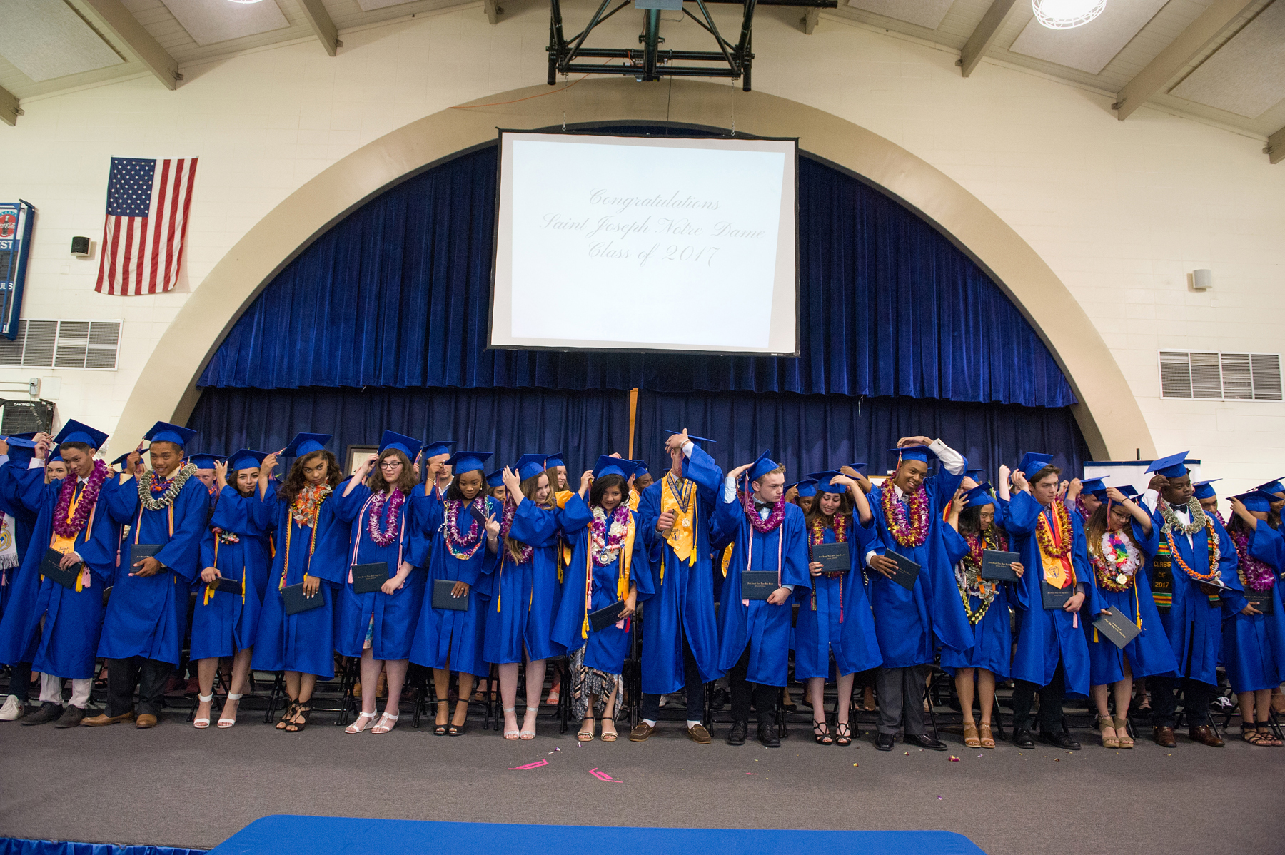 Courtesy photos &nbsp&nbsp&nbsp&nbsp Above, students in St. Joseph Notre Dame's Class of 2017 switch their tassels, making their graduation official. The Alameda Sun thanks the community for these shots.