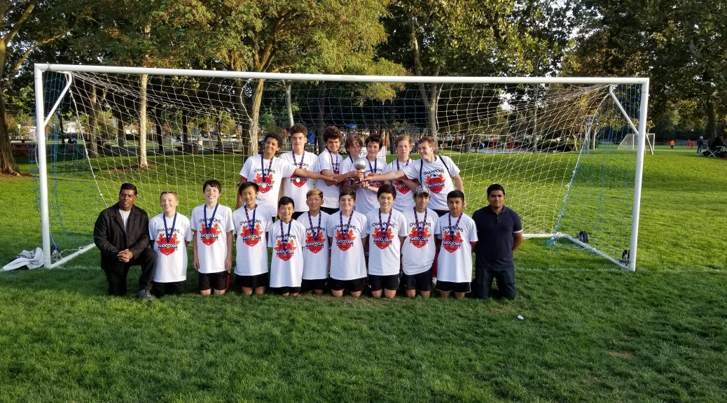 Courtesy Alameda Soccer Club &nbsp&nbsp The Alameda Soccer Club U-16 team the Alameda Falcons celebrate with the trophy after winning the San Ramon Fall Shootout last month.