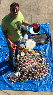 Courtesy photo &nbsp&nbsp Ray Velasco, an Alameda resident and avid surfer who cleans up plastic litter on the shoreline, displays the plastics he culled from San Francisco Bay over the past nine months. Velasco is glad the fee passed and new trash-diversion functionality will be added to Alameda's storm drains.