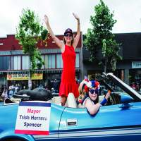 Mayor Spencer both ran in the R.A.C.E. and returned for a second pass on the parade route in the back of a convertible.