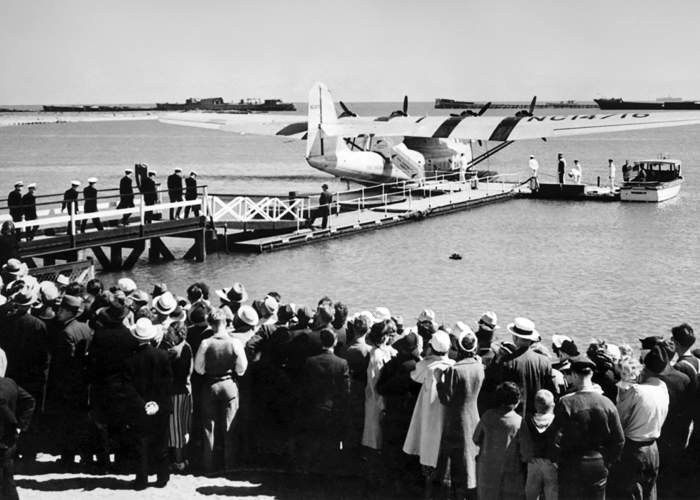 "Library of Congress &nbsp&nbsp Well-wishers look on as Pilot Ed Musick and his crew board China Clipper in Alameda on Nov. 22, 1935, for their historic flight to Manila. Note that the numbers on the wing end with 16. This gave the plane its nickname ""Sweet 16."""