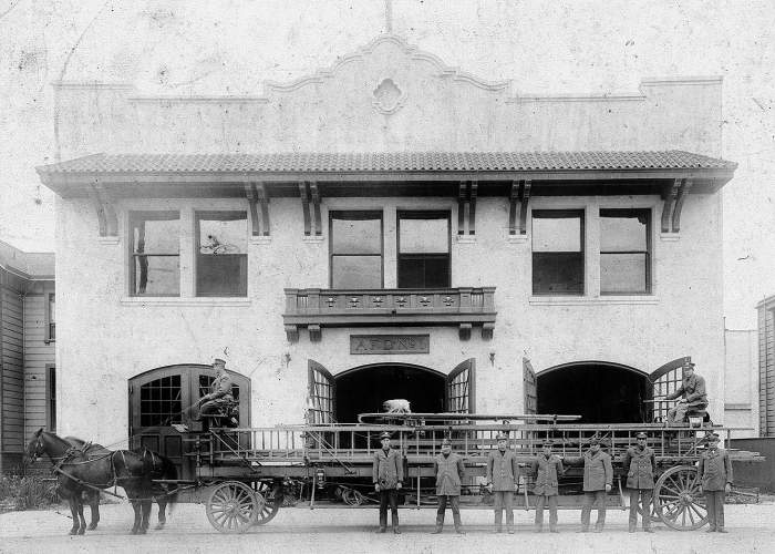 File photo Members of Alameda Fire Department Station No. 1 on Webb Avenue stand in front of their hook and ladder truck and the station in 1910. The first wooden firehouse on Webb Avenue rose up in 1877 to house the Citizens Hook and Ladder Company. The building in this photograph went up in 1908. A hook and ladder apparatus required two drivers, one to steer and control the horses, the other to steer the rear wheels; both are in position in the photograph. Firefighters use ladders to gain access to fires
