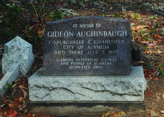Michael Colbruno  Alameda Museum Curator George Gunn spearheaded a movement to mark Gideon Aughinbaugh's grave at Oakland's Mountain View Cemetery. Aughinbaugh's grave was unmarked from his death in 1897 until 1981. It remains unclear where his daughter Ella rests.