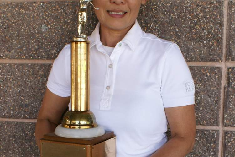 Courtesy photo &nbsp&nbsp Tai Chewpanich displays the President's Trophy she won last Thursday.