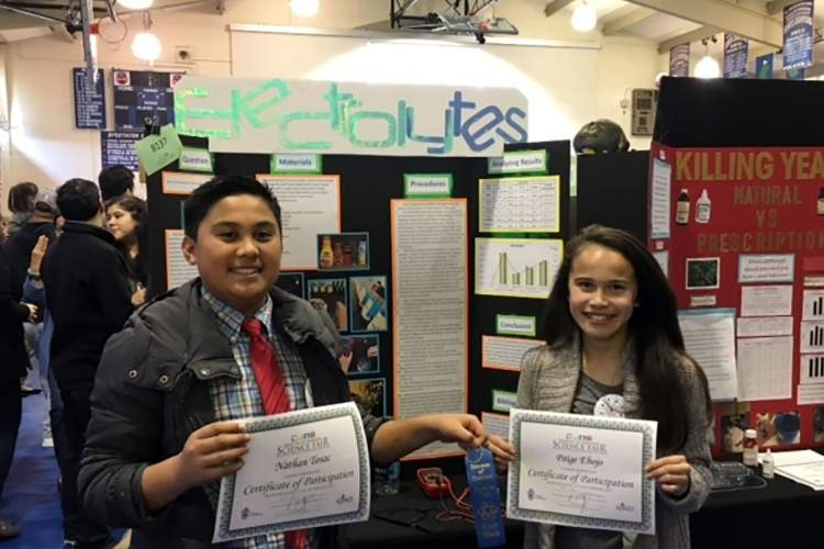 Saint Joseph Notre Dame&nbsp&nbsp Saint Joseph Notre Dame students Nathan Tosac and Paige Ebojo display the blue ribbons they won at the 2017 Diocese of Oakland Science Fair. St. Joe's students are gearing up for this year's fair, which the school will host on Saturday, Feb. 10.