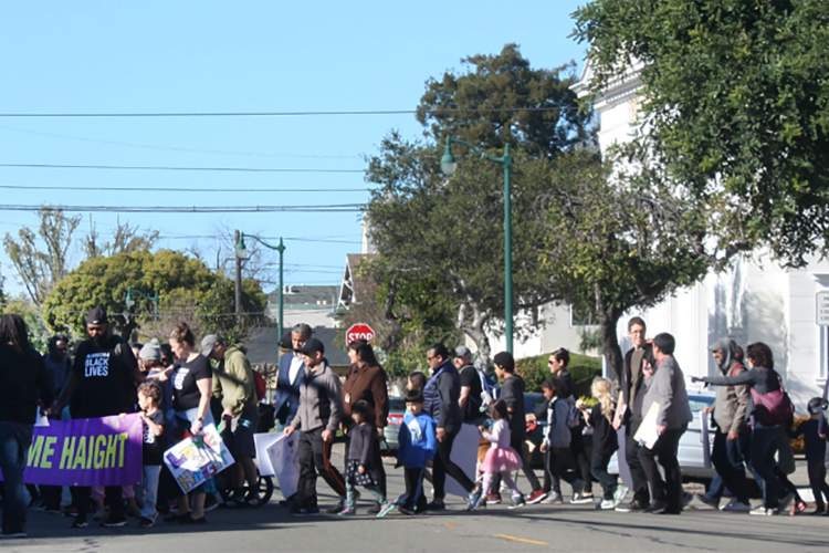Dennis Evanosky &nbsp&nbsp Rally and march participants cross Santa Clara Avenue on their way to City Hall from Haight Elementary School on Monday.
