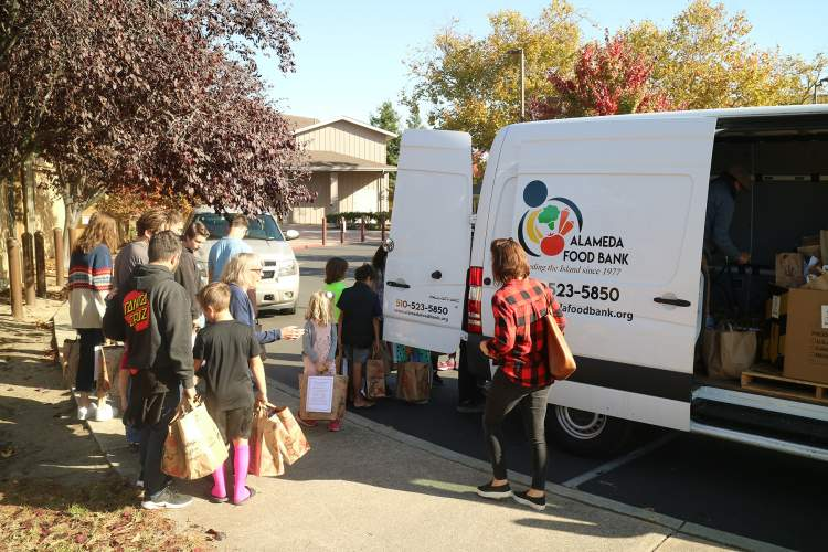 Dennis Evanosky &nbsp&nbsp Students from Temple Israel's Hebrew School and their families helped load a truck from the Alameda Food Bank last Sunday, Oct. 27.