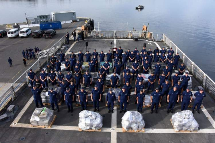 U.S. Coast Guard photo by Petty Officer 3rd Class Aidan Cooney Coast Guard Security Cutter Bertholf's crew stands behind more than 18,000 pounds of cocaine prior to offloading the contraband in San Diego on Dec. 18. The $312 million worth of seized cocaine was the result of seven separate suspected drug smuggling vessel interdictions and disruptions by Bertholf and four other cutter crews who patrolled international waters of the Eastern Pacific Ocean off the coasts of Mexico, Central and South America betw
