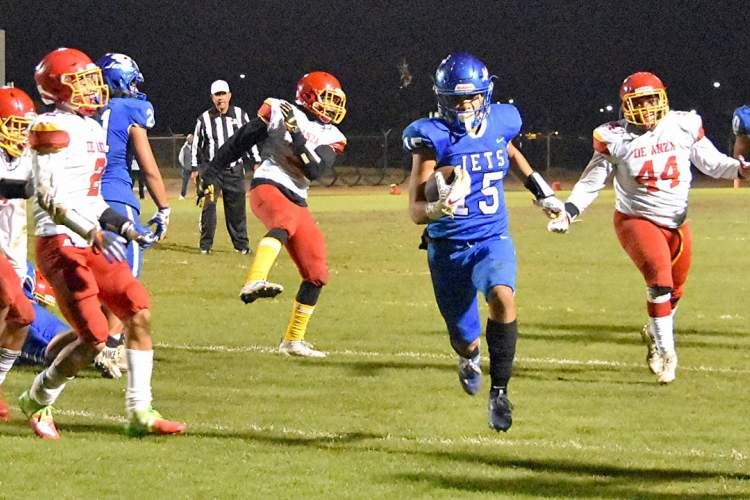 Photos by Charles Penalver &nbsp&nbsp Senior Isaiah Smith runs in a second-quarter touchdown.