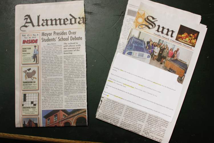 Dennis Evanosky photograph. Sun staff arrived at the office in late November to discover this perfectly bisected copy of the Alameda Sun on the welcome mat and a printed note, with phrases highlighted, packing taped to the door.