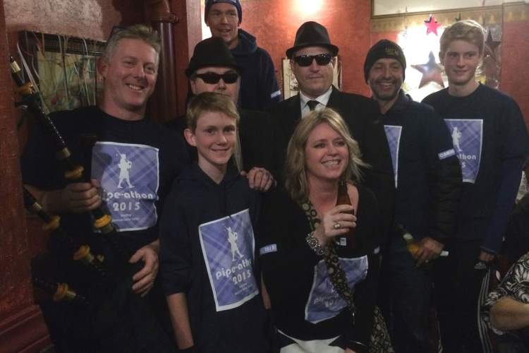 "Courtesy photo  Bagpiper Andy MacKay (left) teams up with the Blues Brothers: ""Joliet"" Jake and Elwood, and lots of other generous Alamedans to raise money to fight cancer during the New Year's Eve Pipe-a-Thon."