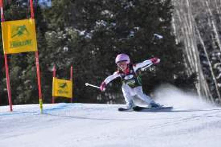 """File photos. Candice Carroll, 7, a second grader at St. Joseph Elementary School won the gold medal in the Bronze Division for 6- and 7-year-old girls at this year's NASTAR National Championships in Aspen, Colo. (""""Seven-Year-Old Takes the Gold,"""" April 5)."""