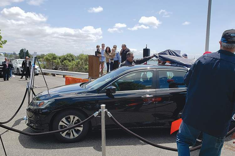 Eric J Kos &nbsp&nbsp A Coast Guard family could barely speak in the face of the huge generosity shown as Alameda's Mike's Auto Body unveiled their newly refurbished Honda.
