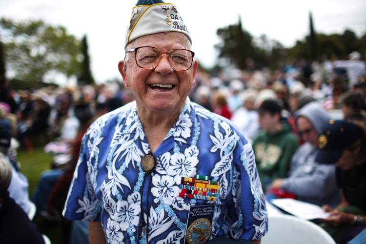 Courtesy photo &nbsp&nbsp Mickey Ganitch, above, a Pearl Harbor survivor who will turn 100 this month, has been a longtime volunteer for veterans' causes. Ganitch will be honored with a special presentation at the USS Hornet Museum's annual Veteran's Day ceremony, Monday, Nov. 11. A special exhibit will also feature the The Flying Tigers, below, who served aboard flights to and from Vietnam during the war.