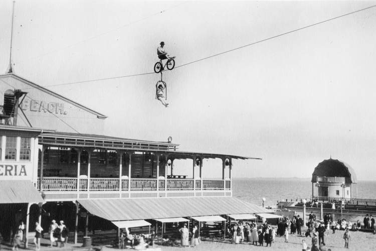 """Courtesy Chuck Millar  During 1920s and '30s, the """"Aerial Thompsons,"""" — known as """"The Kings of the Air"""" and billed in the newspapers as """"a pair of vaudeville artists and headliners"""" — thrilled crowds at Neptune Beach by performing stunts on a wire 175 feet in the air."""