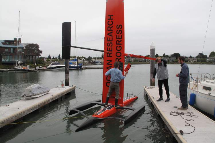 Courtesy photo Members of Saildrone prepare their craft on Ballena Bay. They hope to deploy Saildrones off the California coast later this year to study marine life and collect data.