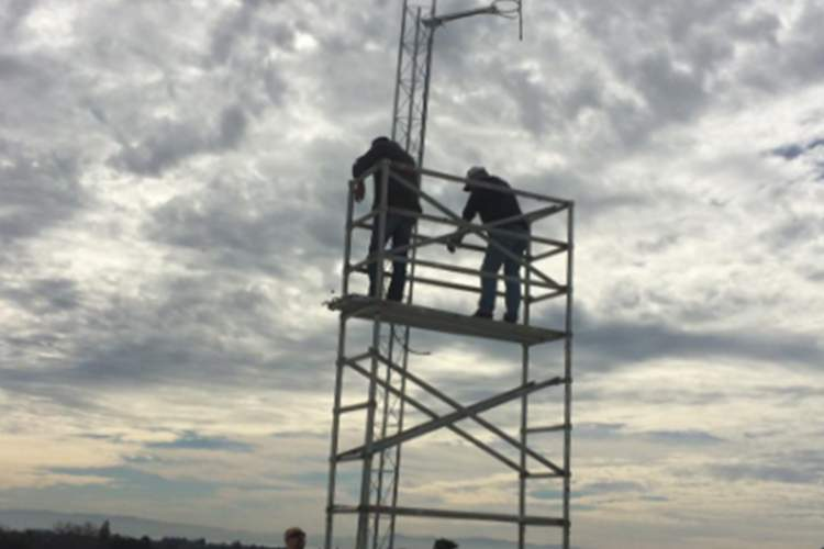 Eric Fonstein  Above, technicians install an antenna and transmitter on the roof of the Masonic Temple on Alameda Avenue. The project, funded with a grant from Alameda Rotary, allows the broadcast of a new radio station in town managed by Encinal Junior and Senior High School Students.