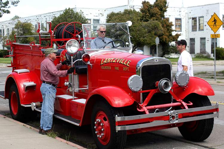 Dennis Evanosky &nbsp&nbsp Richard Bennett, left, and Chris Davis look on as Richard Davis gets comfortable behind the wheel of the 1935 Seagrave pumper that once served Alameda and has come home at last.