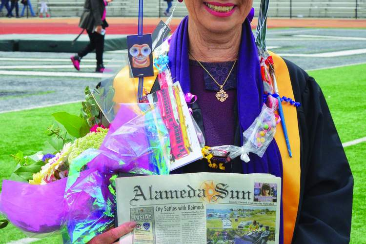 Courtesy photo &nbsp&nbsp Vicki Newcomer celebrated achieving a lifelong goal with some flowers and a copy of the Alameda Sun.