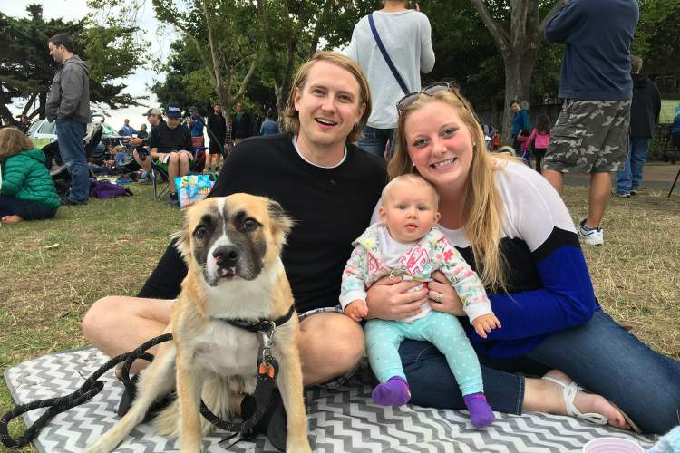 """Jeff Cambra  Bruder the pooch brought his entire family to the """"Dog Days of Summer"""" concert at Crab Cove last Friday. Steve, Amanda and little Halina Bugge enjoyed their picnic dinner while Carne Cruda performed on stage."""