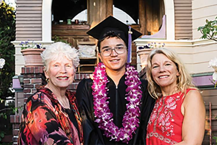 David Parsons &nbsp&nbsp Island High School graduate Ben Pineda Giibson stands front and center flanked by his proud grandmother Janet Gibson (left ) and mother Syliva Gibson (right).