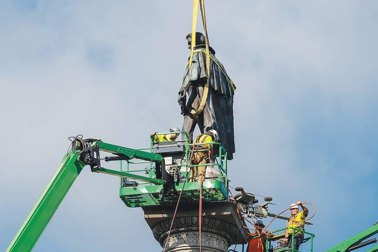 Charleston (S.C.) Post and Courier &nbsp&nbsp Workers prepare to remove the statue of John C. Calhoun from its pedestal on June 24 on Charleston, S.C. Controversy surrounding this statue has led to demands that Calhoun's name be removed from streets, including one in Alameda.