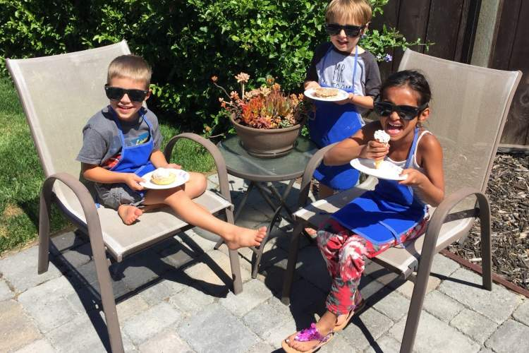 Robin Seeley  Enzo, Julian, and Leilah savor the ice cream they literally made with their own hands. The crispy Italian waffle bowls, cookies and cones enhanced their enjoyment.