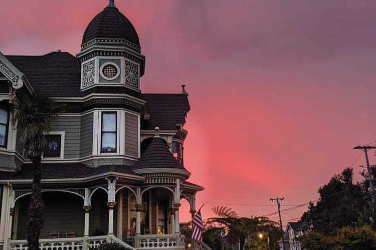 Rafi Avecedo Jr. &nbsp&nbsp The setting sun painted wildfire smoke with a tinge of red on Sunday evening near Alameda's picture-book Victorian-era home at San Jose Avenue and Willow Street.